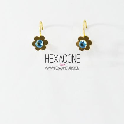 34910bdfd044 HEXAGONE PARIS Joyería – Aretes en Acero 10mm color Dorado con Zircon Azul  – Flores